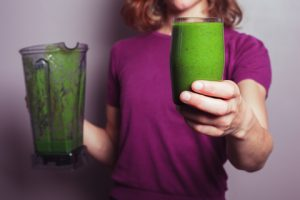 http://www.dreamstime.com/royalty-free-stock-photos-young-woman-green-smoothie-purple-top-holding-blender-glass-fruit-image41102218